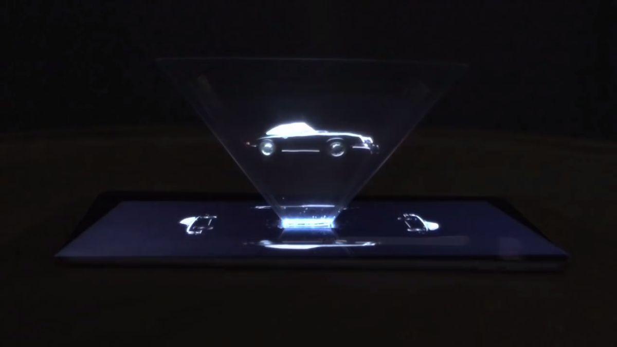 Campagne de publicité Porsche 911 via un hologramme dans un magazine