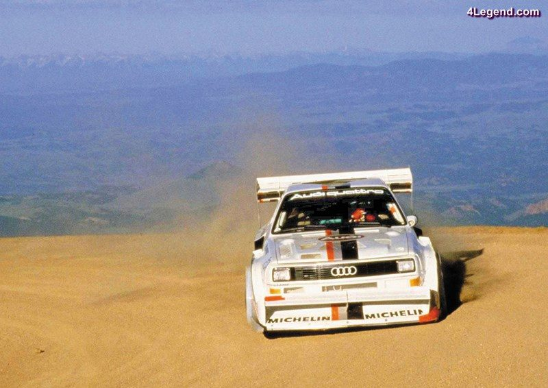 1987: world record at Pikes Peak with the Audi Sport quattro S1 (E2): In 1987, Walter Röhrl wins the legendary Pikes Peak Hill Climb (USA) in the Audi Sport quattro S1 (E2), setting a new record. In 10 minutes and 47.85 seconds he conquers the almost 20-kilometer-long (12.43 mi) course with 156 bends and a difference in altitude of 1,439 meters (4721.13 ft). The 2.1-liter five-cylinder engine in the Audi Sport quattro S1 (E2) delivers 440 kW (598 hp) at 8,000 revolutions per minute and produces 590 newton meters (435.16 lb-ft) of torque at 5,500 rpm.