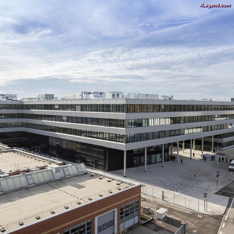 Covering a total area of 24,500 square meters (263,716 sq ft) Audi is making room for a total 2,500 employees. Thanks to a phased construction process, the three- to five-story office environment blends seamlessly into Ingolstadt's cityscape.